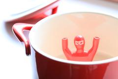 Waving, not drowning (alideniese) Tags: macro closeup smileonsaturday tinytoys toy ninja small tiny ramekin bowl red light bokeh perspective pointofview colour alideniese plastic ceramic