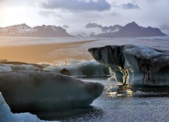 Low sun over Jkulsarlon (ystenes) Tags: lake reflection ice iceland lagoon glacier 1001nights sland icesculptures vestfirir vatnajkull magiccity  jkulsarlon icberg mygearandme mygearandmepremium mygearandmebronze mygearandmesilver mygearandmegold mygearandmeplatinum mygearandmediamond musictomyeyeslevel1 aboveandbeyondlevel1 flickrstruereflection1 flickrstruereflection2 aboveandbeyondlevel2 rememberthatmomentlevel1 rememberthatmomentlevel2 rememberthatmomentlevel3