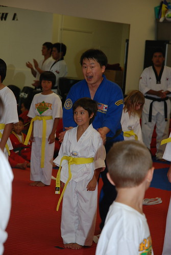 Presenting Olivia with yellow belt