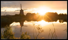 Twiske Molen / Twiske Mill (Joost N.) Tags: park sunset sun holland mill water dutch sunshine amsterdam zonsondergang raw nederland flare mills joost fietsen molen noordholland unedited noord landsmeer reflectie twiske denilp notten twiskemolen