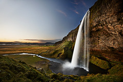 Seljalandsfoss (LalliSig) Tags: sunset summer sky cloud brown black green water grass yellow clouds waterfall iceland polarizer seljalandsfoss