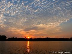 Sunrise - Lake Martin, Louisiana (Image Hunter 1) Tags: trees sky reflection water clouds sunrise louisiana horizon ripples lakemartin cypressislandpreserve panasonicfz35