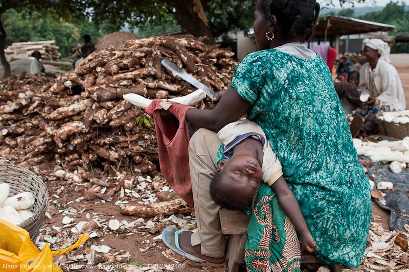 Cassava Peeler and Sleeping Child