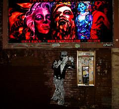 Uncle Sam in Hell (tacosnachosburritos) Tags: city windows columbus ohio art marilyn night america photography graffiti alley phone sam uncle crafts telephone small hell heartland pay monroe shops change voyeurism deity hindi breadbasket