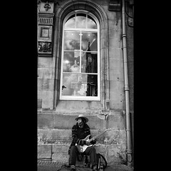 Electric Earth / Acoustic Heaven (40th Anniversary of Jimi Hendrix's Death) (Sator Arepo) Tags: leica portrait urban blackandwhite bw musician music window hat electric scotland edinburgh sitting song banjo escocia fender hendrix busker 169 edimburgo stratocaster dlux dlux4