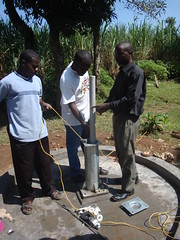 Ebumamu primary school rehabilitated well-installation of rising pipes during pump installation.