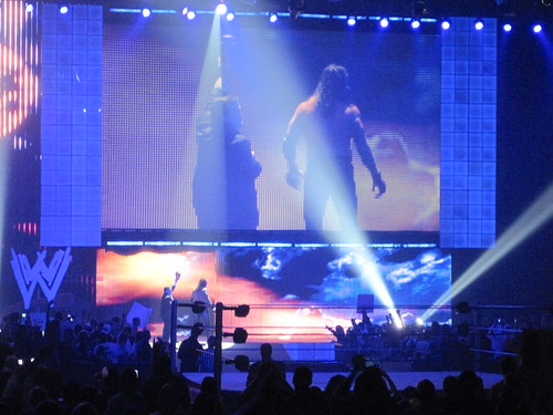 Undertaker and Paul Bearer leave the arena