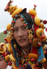 khampa tibetan girl with vast wonderful treasures (BetterWorld2010) Tags: tibetans coral festival gold amber necklace beads costume treasure dress jewelry tibet ring celebration bracelet amdo kham sichuan traditionalcostume 2009 litang headdress robes yushu  tibetanwoman    khampa golok lithang tibetangirl tribalcostume tibetanfestival  tibetanwomen