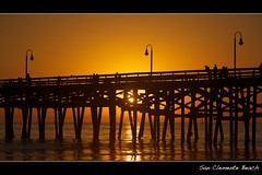 sunset pier (Eric 5D Mark III) Tags: ocean california sunset people orange seascape beach water silhouette yellow golden pier mood atmosphere orangecounty sanclemente tone ef70200mmf28lisusm