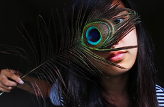 Shade (lucyintheskeye) Tags: lighting portrait girl face contrast self dark asian feather peacock hidden identity hide shade mysterious