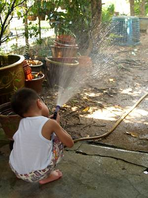 Julian spraying water