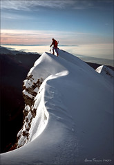 Marco on top, facing the sea (arunte) Tags: winter italy mountain snow mountains sunrise topf50 nikon italia mare hiking climbing tuscany mountaineering kodachrome toscana montagna apuane appennino apennines nikonfm sagro spallone mygearandmeplatinum mygearandmediamond marcofrancini arunte artistoftheyearlevel4