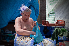 Mushrooms seller (Che-burashka) Tags: street portrait england people man london mushrooms market candid places amazement deptford signing seller gentleman londonist ef28mm nakedtorso canonef28mmf18usm