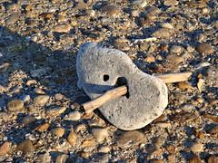 Sunset light over a piece of art (CameliaTWU) Tags: beach rock sand holes romania stick sunsetlight blacksea neptun rockwithholes