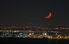 Moon Over Bayonne Tuesday Night (Jay Fine) Tags: orange moon night landscape newjersey nj cranes bayonne crescentmoon