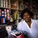 Woman in small shop Ghana