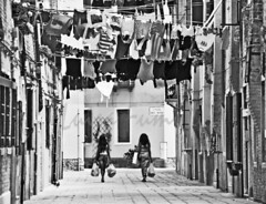 The other Venice - washing day (Luisa Fumi) Tags: street city venice houses people urban blackandwhite italy horizontal buildings shopping photography europe cityscape laundry walls passage popular ethnic picturesque oldtown washing everydaylife shoppingbags pedestrianpassage twogirlsindistance
