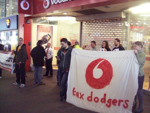 With a Vodafone tax dodger banner.