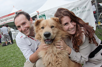 Fluffy tan dog with his new adoptive family
