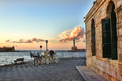 Chania (Theophilos) Tags: sunset sea sky horse lighthouse clouds coach greece crete chania  oldharbour