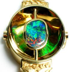 Black Opal:  Detail of Scott Schreiber One-of-a-Kind (theappraiserlady) Tags: color gold design polish jewelry iridescence oro lightningridge blackopal joyas playofcolor customjewelry finejewelry theappraiserlady oneofakinddesignerjewelry