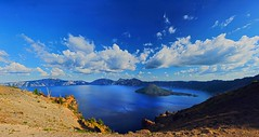 Take me to see the Wizard (Deby Dixon) Tags: panorama tourism beautiful clouds oregon photography volcano travels nikon all rights craterlake reserved wizardisland deby 2010 craterlakenationalpark debydixonphotographydeby