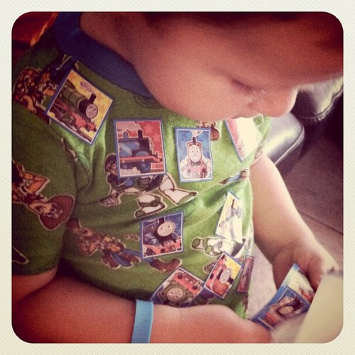 Covering himself in Thomas stickers... Choo Choo!