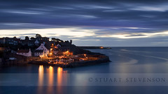 The harbour revisited... (Stuart Stevenson) Tags: longexposure buildings reflections dark boats lights scotland ancient harbour fife historic bluehour fishingboats 800ad quaint twinkling lobsterpots costal whitewashed earlyinthemorning crail fishingharbour eastneukoffife royalburgh redtiledroofs 3minutes 180seconds themedweek canon5dmkii stuartstevenson idolovetobebesidethesea