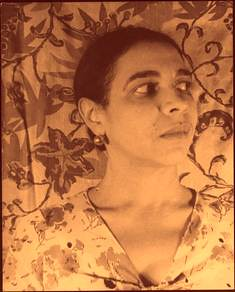 a sepia photo of Larsen. She is facing the camera but looking away apprehensively.