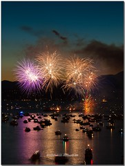 P7244891-f (Nuclear-Powered) Tags: ocean sea summer canada reflection water night vancouver boats downtown bc fireworks britishcolumbia burrardinlet englishbay celebrationoflight cypressmountain burrardstreetbridge teamspain olympuspenep1 nikonnikkor3570mmf35~48