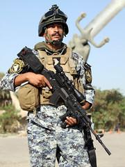 Iraqi MOI Police... (Colonel Killgore) Tags: portrait man male soldier uniform gun scope iraq rifle helmet goggles police security moi camouflage baghdad bodyarmour crossedswords ministeryofinterior
