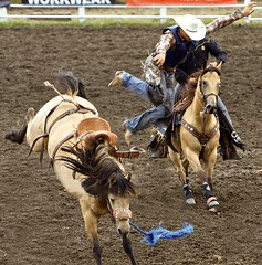 The Dismount (Ken Yuel Photography) Tags: canada boots wranglers manitoba rodeo morris saddles stampede buckingbronco stirrups inspiredbylove saddlebroncriders digitalagent thedismount kenyuel