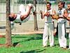 capoeira (Edison Zanatto) Tags: brazil southamerica brasília brasil nikon capoeira berimbau salto esporte nikonn90s americadosul centrooeste fujicolorprovalue200 filme35mm regiãocentrooeste continentesulamericano edisonzanatto