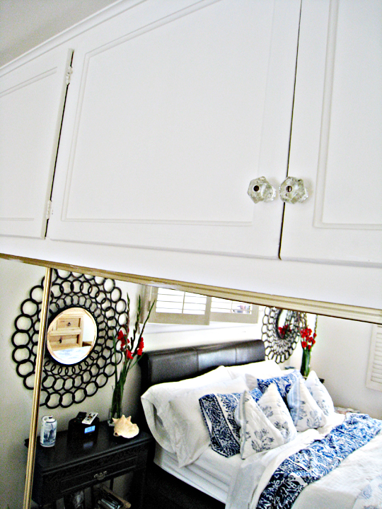 vintage glass knobs+circle mirrors+master bedroom+beach accents