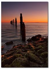 Sunshine on the Rocks (danishpm) Tags: ocean orange sunrise canon pier rocks australia wideangle brisbane qld aussie aus 1020mm manfrotto sigmalens shorncliffe eos450d 450d mywinners bestofaustralia dragondaggerphoto dragondaggeraward bestofmywinners sorenmartensen hitechgradfilters 09ndreversegradfilter