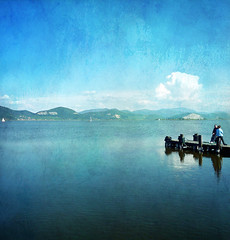 Water, Sky and Secrets (Visualtricks) Tags: blue two sky italy lake water clouds reflections square boats pier women textures tuscany explore472 magicunicornverybest magicunicornmasterpiece magiayfotografia