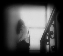 Looking for me (Manhattan Girl) Tags: bw selfportrait window textured stairrailing relecting 10secondtimerdash texturefromlesbrumes