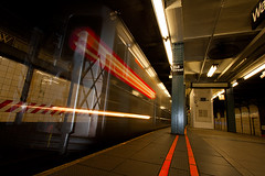 Speeding Through Wall (Photos by Marc) Tags: newyorkcity longexposure light red orange 3 newyork motion blur lines station speed train canon subway lights movement raw perspective wideangle motionblur trainstation canondigitalrebel subwaystation wallstreet streaks digitalrebel speeding xsi slowshutterspeed cameraraw leadinglines canonefs1022mmf3545usm canoneosdigitalrebel subjectblur 450d canon450d canoneosdigitalrebelxsi