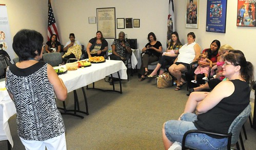 Norma Dominguez, Peer Counselor at Shenandoah Valley WIC and Nutrition Services, chats with expecting and nursing mothers at the community breastfeeding support group August 6 in Martinsburg, West Virginia.