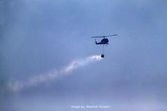 UH-1H Super Huey, CalFire, Bodega, California (Wernher Krutein) Tags: california usa fire flying chopper aircraft aviation flight hills huey helicopter bodega petaluma sonomacounty blaze firefighters vtol helo wildfire whirlybird rotorcraft helitack waterbucket firebomber uh1h rotarywing superhuey calfire bodegafire