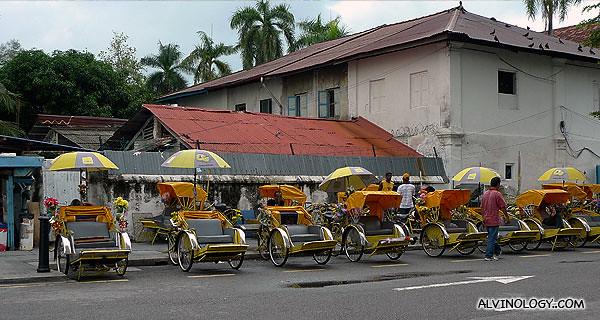Row of trishaws outside Hotel Malaysia