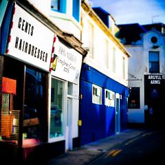 Blind Drunk Barber (gregorcinema) Tags: street blue colour pub dof argyll barber hairdresser isle gents bute rothesay