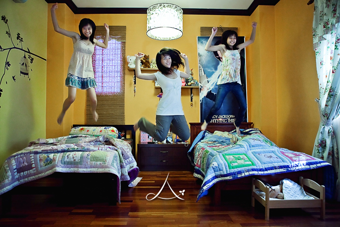Some girly jumping in their bedroom. :P