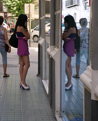 Seeing double (Kombizz) Tags: people woman reflection girl car sunglasses fashion mobile standing bag spain cityscape phone legs display double andalucia espana seeing mobilephone bracelet costadelsol chatting miniskirt seeingdouble highheelshoes kombizz