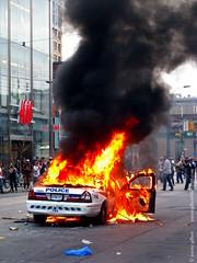 Burning police car, black smoke, Toronto G20 (jer1961) Tags: toronto fire riot police policecar queenstreet riotpolice torontopolice g20 groupof20 g20riot g20intoronto torontog20 torontoriot torontog20riot