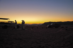 Sunset Prayer (Baker Stass) Tags: travel sunset red sky sun mountains tourism nature landscapes sand rocks desert horizon wadirum prayer middleeast jordan explore hkj moonvalley