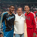 Point Guards John Wall and Derrick Rose pose with their former college head coach John Calipari