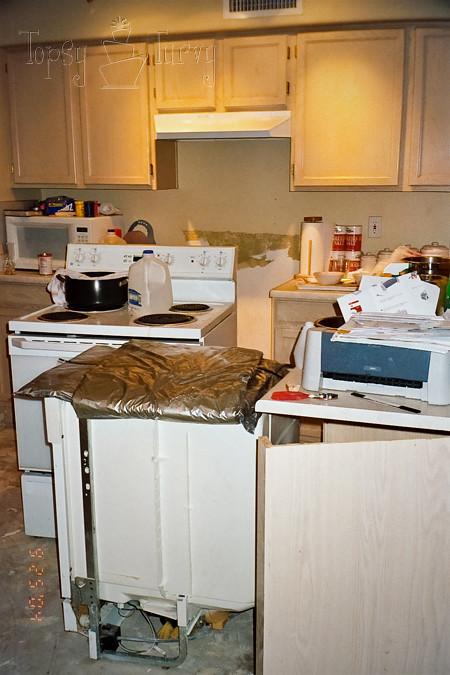 Tiling Kitchen Floor Around Cabinets