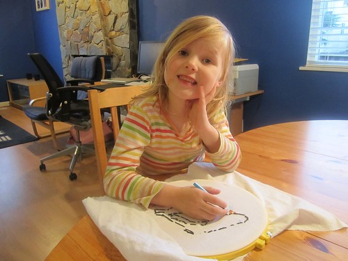 Hannah drawing an embroidery pattern
