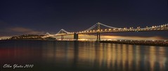 Panorama of Bay Bridge - HDRI (Ellen Yeates) Tags: ocean california city travel bridge light sunset vacation sky panorama cliff reflection water night canon island bay pier ellen san glow dusk hdr hdri franscisco yeates